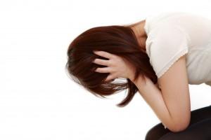 塞ぎ込む女性 挫折